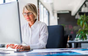Woman on her computer in the office.