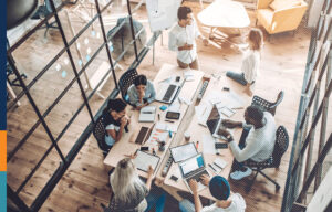 Overhead shot of a team working in an office.